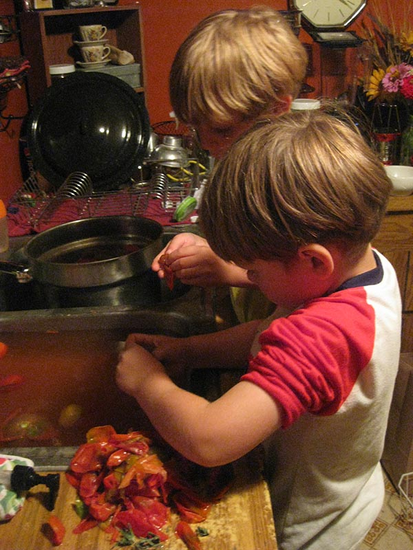 Peeling tomatoes is simple, but when ploughing through a large batch, it certainly helps to have all hands on deck. :)